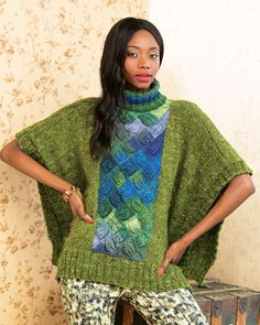 18 – Entrelac Poncho   Ponchos are firmly back in the mainstream. Make a unique color statement with this lace-detail entrelac!
