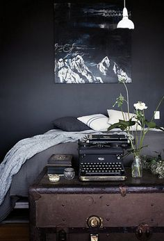 black paint, old trunk and a typewriter. All the decor you need :)