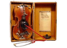 """Violin Vibrophone is. I was told that it was a quack cure used for Tinnitus. It was able to be tuned to match the ringing in a subjects ears. There are 2 black wooden receivers included with the kit. The instructions read… """"The Larger receiver is for the more chronic cases"""". I'm sure the patient was thrilled to know the frequency at which their ears would start to ring"""