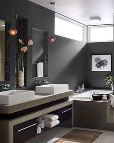 Great contemporary bath in black. I love the minimalist lighting of the square flush mount over the tub and the small pendants over each sink.