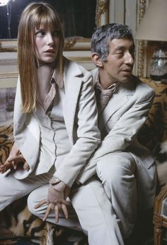 The singers Serge Gainsbourg and Jane Birkin wearing Cerruti creations, at their apartment on Verneuil Street in Paris, 1969.