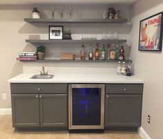 Finally finished basement bar! Unfinished cabinets, IKEA countertop and IKEA floating shelves (painted to match cabinets - SW Porpoise)