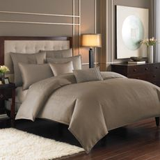 Nicole Miller® Currents Driftwood Duvet Cover - on black furniture with taupe walls and a splash of color.
