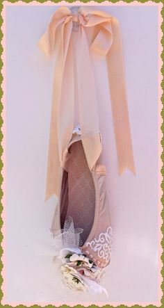 This stunning repurposed genuine pointe shoe is hand decorated extensively with stunning cotton lace, pearls and beautiful paper flowers, in the