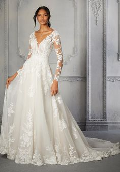 This glitter net A-line ball gown features sheer long sleeves, and a v-neckline. Bridal Wedding Dresses, Wedding Dress Styles, Dream Wedding Dresses, Designer Wedding Dresses, Bridal Style, Lace Ball Gowns, Tulle Ball Gown, Chelsea Wedding, Mob Dresses