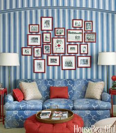 Red bamboo frames unite family photographs in the wife's office. Ottoman in Jane Shelton's Satin linen. Patterned pillows in a Carolina Irving fabric.   - HouseBeautiful.com