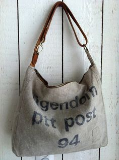 Up-cycled vintage postbag made  by BooneStaakjeS on Etsy, $103.00