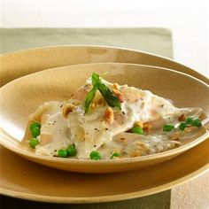 Butternut Squash Ravioli with Whiskey-Sage Cream Sauce: The flavors of Americana -- smooth rye whiskey and fragrant sage -- provided inspiration for this butternut squash ravioli with a rich whiskey-sage cream sauce.  #gourmet #recipes #pasta