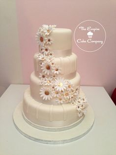 Cascading Daisies Wedding Cake.That looks nice.Please check out my website thanks. www.photopix.co.nz
