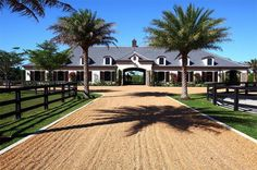 A dramatic barn entrance and a beautiful stable in Florida
