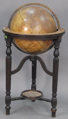 Terrestrial globe by Phillips on stand with turned and fluted legs with compass base, 19th century (no needle). Realized Price: $2,596.00