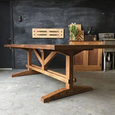 Built from solid reclaimed and rough sawn red oak this farm table commands the attention of the room. Complete with breadboard ends and an elaborate