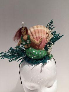 A personal favorite from my Etsy shop https://www.etsy.com/listing/235101319/mermaid-headband-shell-crown-seashell
