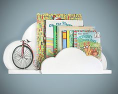 Give a collection of vintage storybooks presented on a irresistible cloud shelf.