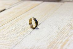 This unisex ring composed mahogany wood and brass.  All the steps are handmade by me. A wonderful treat for yourself or a friend!  You can wearing everyday to office or any other occasion. Very elegant ring.  Size: in all size available!