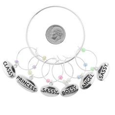 Wine Charms ~ Silvertone Descriptive Wine Glass Charms Set of 6 (Classy, Princess, Sassy, Bossy, Angel and Sassy Again) ( Style Wine Charm 044b 20) by Variety Gift Shop. $10.50. set of 6/ wine charms/ metal/ tension hook/ charm organizer ring included/ lead & nickel safe. set of 6/ wine charms/ metal/ tension hook/ charm organizer ring included/ lead & nickel safe. Save 47% Off!