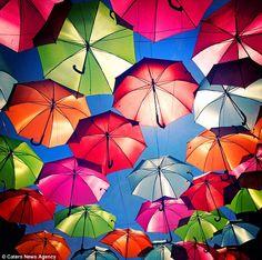 Floating Umbrella Installation in Agueda, Portugal.