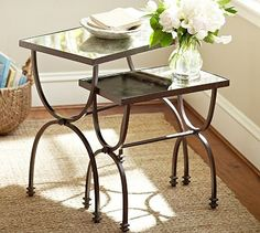 """Willow Nesting Tables, Set of 2 #potterybarn Our nesting tables are ideal for entertaining because they offer quickly expandable serving space. Mirrored tops and curving bases make a striking backdrop for display. Place prized possessions on top to highlight their detail from every angle. Small: 19"""" wide x 11"""" deep x 19.5"""" high  Large: 24"""" wide x 15"""" deep x 24.5"""" high  Forged iron frame and antiqued-mirror tops.  Hand-applied multistep matte finish in Dark Bronze."""