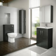 This stunning black bathroom design would make a statement in any home. This bathroom suite package from Victorian Plumbing includes a wall hung black bathroom cabinet, vanity unit, black mirrored cabinet and a black WC toilet unit. White Storage Cabinets, Tall Cabinet Storage, Furniture Vanity, Bathroom Furniture, Freestanding Vanity Unit, Back To Wall Toilets, Black Vanity, Furniture Packages, Bathroom Colors
