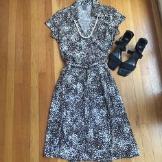 """Ann Taylor wrap dress. Brown and white. Ann Taylor wrap dress.Brown and white.Size 8 that adjust somewhat because it is a wrap. Between under arms 18"""".Shoulder-hem 41"""". Very chic. Ann Taylor Dresses Midi"""