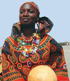 Africa   Woman wearing the traditional dress from Cameroon   Photographer unknown