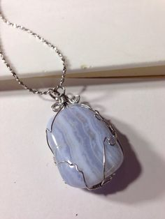 In memory of my mother my first attempt at wire wrapping was to use a blue lace agate from my mother's collection of stones for my youngest daughter Wendy.