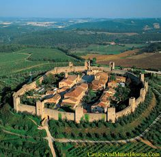 Monteriggioni,.... Siena, Tuscany, Italy. http://www.castlesandmanorhouses.com/photos.htm ... Monteriggioni is a medieval walled town, located on a natural hill, built by the Sienese in 1214–19 as a front line in their wars against Florence. The walls follow the natural contours of the hill. There are 14 towers on square bases, and two gates. Monteriggioni is mentioned in Dante Alighieri's Divine Comedy.