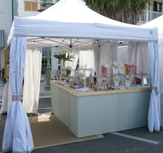 Craft show booth setup idea. Creating a display desk within the space