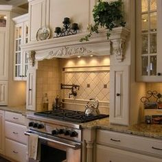 love this mantle over the stove, makes it feel like you're cooking in a fireplace!