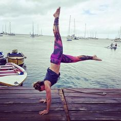 L-Kick handstand practice in Spiritgirl tropical yoga pants. Palm trees and island life.
