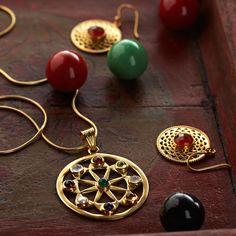 A hand-set rainbow of gems—garnet, citrine, peridot, amethyst, onyx, moonstone, carnelian, and pearl—in a sunburst pattern framed in 22-karat gold vermeil. Jaipur Sun Jewelry | National Geographic Store