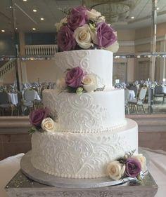 Calumet Bakery Classic scroll work looks beautiful on this white wedding cake...