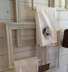 White washed or distressed picture frames make unique towel racks that also doubles as wall art!