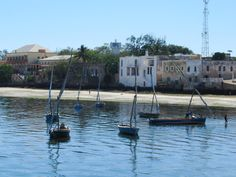 Colonial buildings still occupy much of the northern half of Mozambique Island. East Africa, Portuguese, Colonial, Buildings, Boat, Island, Dinghy, Boats, Islands