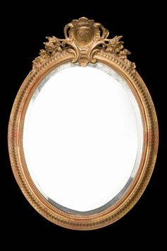 Chippendale Period Oval Mirror -                          A fine Chippendale period Oval Mirror with inner bead carved border surrounded by an egg and dart section all within a concave outer edge. The top with a fine and elaborate cartouche framed within an elaborate surround.  c. 1760 -   Height 43.00inch (109.22cm),  Width 30.00inch (76.20cm),  Depth 4.00inch (10.16cm)