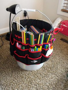 The Portable Art Studio, which is essential a craft bucket with pockets around it. Simple, and easy to organize supplies in.