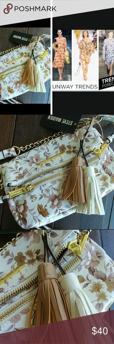 Steve Madden crossbody bag Flower power Embrace the flower power trend, amazing quality,  Vegan canvas 9 wide 7 hight 22 inches shoulder down with adjustable strap.  The flower power is in mauve colors, with strikes of yellow Bags Crossbody Bags