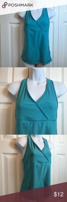 "Danskin Now Teal Athletic Yoga Work Out Top sz S Danskin Now Teal Athletic Yoga Work Out Top sz S Racer Back Shelf Bra Measurements Taken Unstretched Bust: 30"" Length: 24"" Danskin Tops Tank Tops"
