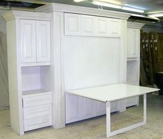 It's a murphy bed and craft table! Perfect for our future guest room! I think this one is kind of ugly, but a more modern simple design would be awesome! www.flyingbeds.com