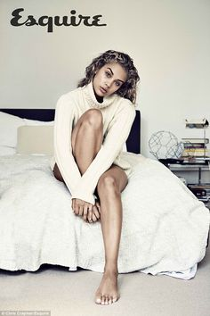 Warm and fuzzy: Jasmine Sanders wrapped up in a man's sweater and still sizzled...