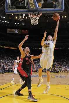 OAKLAND, CA - MARCH 4: Klay Thompson #11 of the Golden State Warriors shoots a layup against Jonas Valanciunas #17 of the Toronto Raptors on March 4, 2013 at Oracle Arena in Oakland, California.
