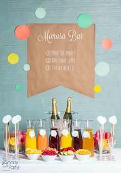 """Nothing says """"bridal shower"""" like delicious sparkling refreshments like this mimosa bar with champagne, juices, and fresh fruit."""