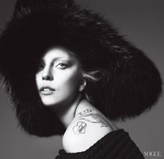 """I don't want to settle down yet,"" Gaga says. ""I just want to keep riding this rainbow."" Marc Jacobs black fox Edwardian hat and crocheted-wool scarf."