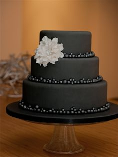 Over the hill birthday party? Or super chic wedding that's all black and white? Interesting. Less is more Cake ~ beautiful!
