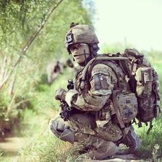 A British Army Gurkha soldier from the 2nd Battalion, The Royal Gurkha Rifles takes a knee during a patrol in Southern Afghanistan.