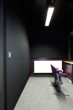 RPG products: RPG Flutterfree T and RPG QRD734's all in custom aubergine colour with balustrade to match.  Soundtrac the stretch fabric lining in black featured on the back walls. Photos by @adamcoupe  #acoustics #rpg #flutterfreet #soundtrac #qrd734 #school