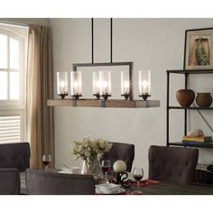Illuminate your home with the rustic charm of the Vineyard 6-light Metal and Wood Chandelier. This unique light fixture features a rectangular shaped frame made of warm brown wood that is accented by black metal and glass shades.