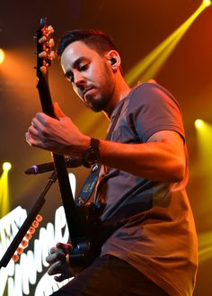 Mike Shinoda Photos Photos - Musician Mike Shinoda performs onstage during the iHeartRadio album release party with Linkin Park presented by Clear Channel at the iHeartRadio Theater on June 18, 2014 in Burbank, California. - Linkin Park for iHeartRadio Live