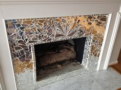 Yes this is a mosaic of broken mirror. Screams out - Country Music Diva - Fireplace Stained Glass Mosaic, Broken Mirror Projects, Mosaic Mirror, Mosaic Fireplace, Mosaic, Fireplace Decor, Fireplace Mirror, Mirror Mosaic, Diy Mirror