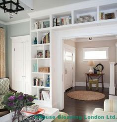 """Built ins define an entry via BHG. DIY Built-in IKEA Bookshelves: """"Built-in bookcases not only add a ton of character and storage, but they really can make a small house feel so much bigger!"""" - love the colors in the living room and hallway Ikea Bookcase, Bookshelves Built In, Billy Bookcases, Book Shelves, Glass Shelves, Small Shelves, Bookcase Door, Living Room With Bookshelves, Organizing Bookshelves"""